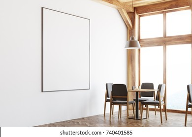 Bar interior with white and wooden walls, a square table with gray and wooden chairs near a large window. A framed poster on the wall. 3d rendering mock up