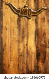 barbecue insignia with horns on a wooden wall