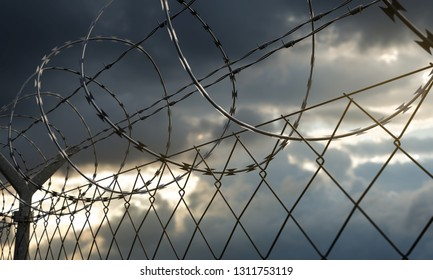Barbed wire fence with dramatic sky (3D Rendering)