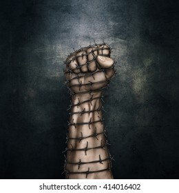 Barbed wire fist / 3D illustration of grungy raised fist wrapped in barbed wire against dark stone background