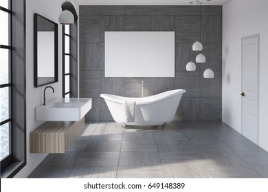 Bathroom interior with a gray tiled wall, a white bathtub, a horizontal poster above it and a sink with a mirror. 3d rendering, mock up