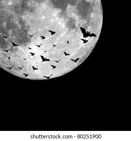 Bats flying in the night with a full moon in the background. Perfect background for Halloween concept and with plenty of space for text or image