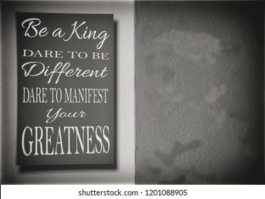 Be a King. Dare to be Different, dare to manifest your greatness. Dirty concrete background. Motivation, poster, quote, blurred image.