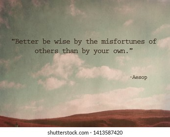 """""""Better be wise by the misfortunes of others than by your own."""" – Aesop Quote on vintage mountain background"""