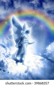beautiful angel over sky with divine rays of light and divine rainbow