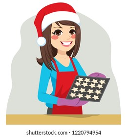 Beautiful brunette woman on Christmas time baking cookies