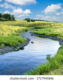 Beautiful cold creek running through a scenic meadow landscape in summer, 3d render with photographic elements.