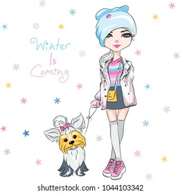beautiful fashion hipster girl in winter clothes, sneakers, jacket and skirt with cute dog Yorkshire terrier