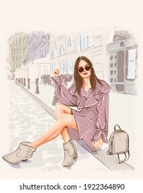 Beautiful girl, sitting on the sidewalk