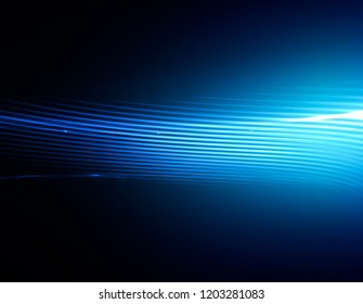 Beautiful light flares. Glowing streaks on dark background. 