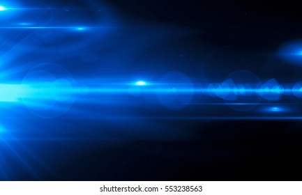 Beautiful light flares. Glowing streaks on dark background. Luminous abstract sparkling lined background. light effect wallpaper