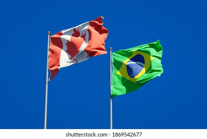 Beautiful national state flags of Brazil and Canada together at the sky background. 3D artwork concept.