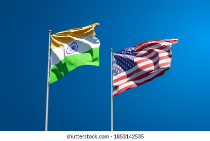 Beautiful national state flags of India and USA together at the sky background. 3D artwork concept.