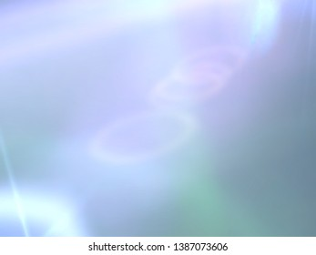 beautiful opal rainbow color flare light with blue sky background