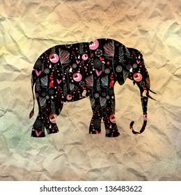 beautiful ornamental elephant on textural background