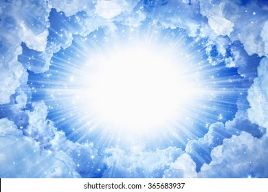 Beautiful peaceful background - beautiful blue skies with bright beams from above, light from heaven