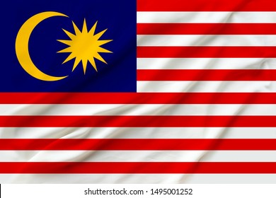 beautiful photo of the national flag of Malaysia on delicate shiny silk with soft draperies, the concept of state power, country life, horizontal, close-up, copy space
