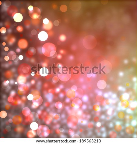 beautiful red pink and gold bokeh background with shimmering white christmas lights or celebration lights