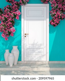 Beautiful roses and door in front of blue wall. Entrance of a house.
