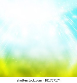 Beautiful summer easter background with beautiful green grass and blue sky colors and sun light