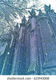 Beautiful winter in old European city - snowfall, facade of Gothic Cathedral and tree branch. Lille, France.  Vertical colored Illustration in engraving style.