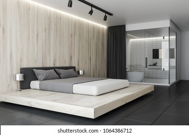 Bedroom Interior With Light Wooden Walls And Floor And A King Size Bed. A  Bathroom