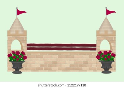 Beige brick castle tower horse show jump with roses in black urns and burgundy wood poles.