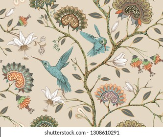 Beige seamless pattern with stylized flowers and birds. Blossom garden with hummingbirds and plants. Light floral wallpaper with decorative flowers. Design for fabric, textile, wallpaper, cover
