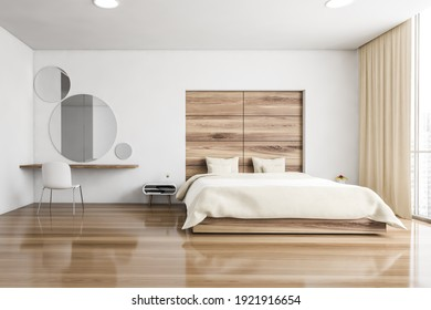 Beige sleeping room, bed and chair with desk on parquet floor. Minimalist design of bedroom with coffee table, windows with city view, 3D rendering no people