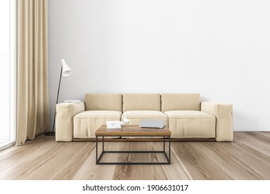 Beige sofa in minimalist living room with parquet floor. Couch near window with curtains and white wall. Coffee table with laptop, 3D rendering no people