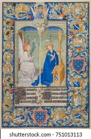 BELLES HEURES OF JEAN DE BERRY, by Limbourg Brothers, 1405-09,French painting, Northern Renaissance. An Annunciation page from an illuminated manuscript. The central scene is bordered by a complex int