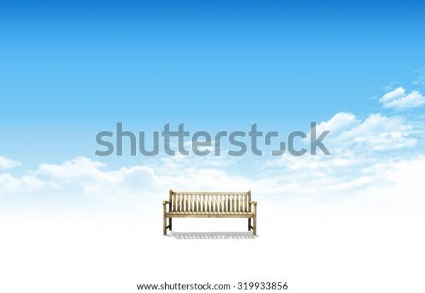 bench in blue sky field