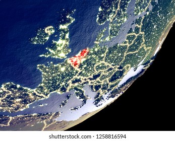 Benelux Union from space on model of Earth at night. Very fine detail of the plastic planet surface and visible bright city lights. 3D illustration. Elements of this image furnished by NASA.