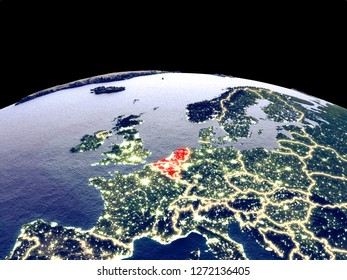 Benelux Union from space on planet Earth at night with bright city lights. Detailed plastic planet surface with real mountains. 3D illustration. Elements of this image furnished by NASA.