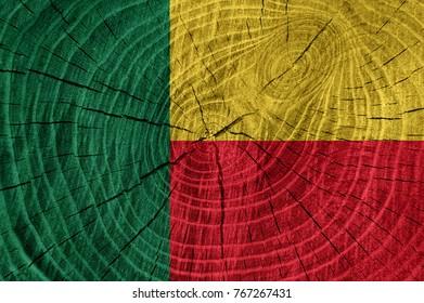 Benin flag on wood texture background