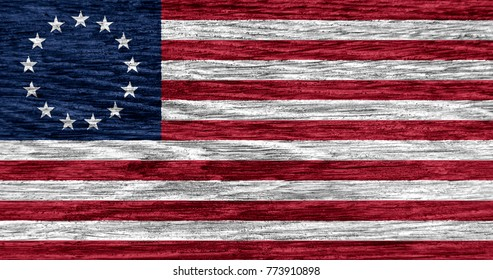 Betsy Ross flag on wood texture background