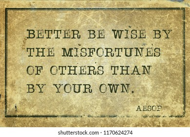 Better be wise by the misfortunes of others than by your own - famous ancient Greek story teller Aesop quote printed on grunge vintage cardboard