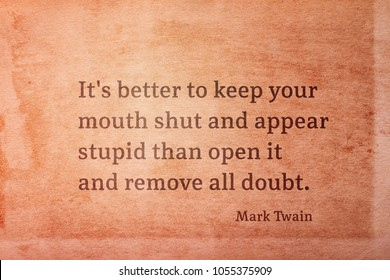 It's better to keep your mouth shut and appear stupid - famous American writer Mark Twain quote printed on vintage grunge paper