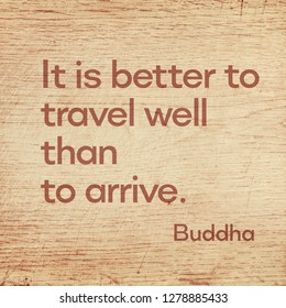 It is better to travel well than to arrive - famous quote of Gautama Buddha printed on grunge wooden board