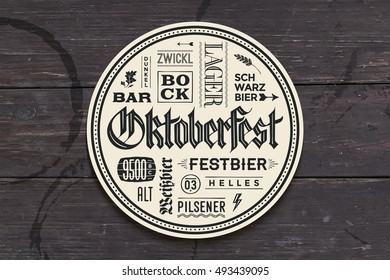 Beverage coaster for beer with hand drawn lettering for Oktoberfest Beer Festival. Vintage drawing for bar, pub, beer themes. Circle for placing a beer mug or a beer bottle. Illustration