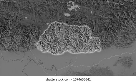 Bhutan area on the grayscale elevation map in the stereographic projection - raw composition of raster layers with light glowing outline