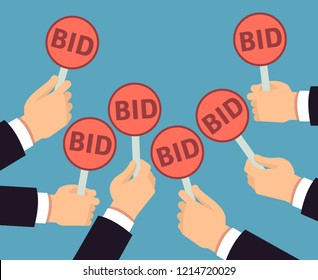 Bidder hands holding auction paddle. Buyer business concept