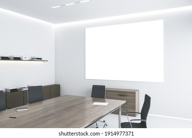 Big blank white poster on light wall under led lights in modern eco style office with wooden furniture and white floor. Mockup. 3D rendering