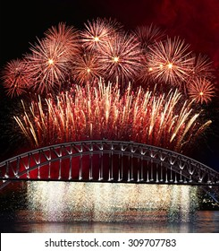 Big and bright fireworks explosions over the Sydney Harbour  bridge. Celebration concept with massive fireworks display.