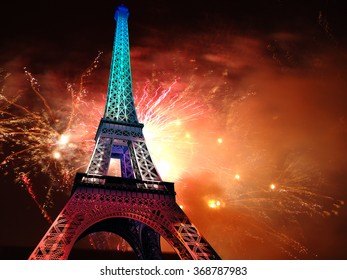 Big and bright fireworks explosions over the  Eiffel Tower. July 14th celebration background