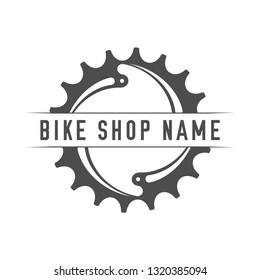 Bikes Shop Emblem. Design Element for Bike Shop or Advertising Banner. Chainring and Place for Your Bike Shop Name, Monochrome Illustration.