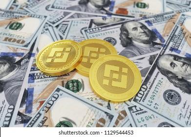 Binance Coin Symbol And Dollars. 3D Illustration of Gold Binance Coin And One Hundred Dollars Background. 3D rendering.