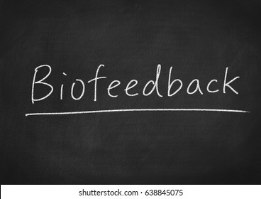 biofeedback concept word on a chalkboard background