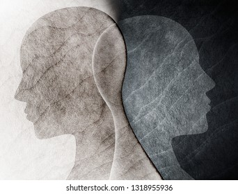 Bipolar disorder mind mental concept. Change of mood. Emotions. Split personality. Dual personality. Head silhouette of man on black and white background