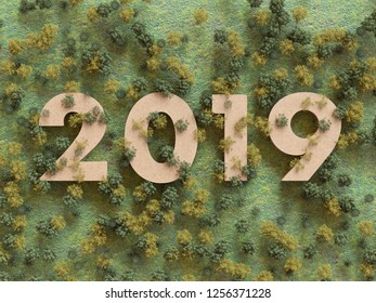 Birds eye view of the year 2019 made of cardboard surrounded by trees in the forest, 3D render